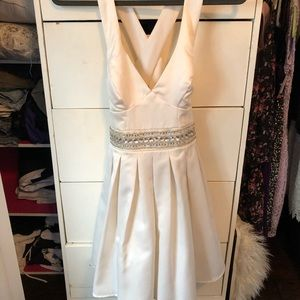 Cream/off white silk short dress with open back.